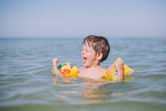 Happy boy playing at sea Stock Photography