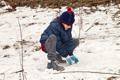 Happy boy is playing with snow Royalty Free Stock Photo