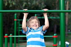 Happy Boy playing sports outdoors Royalty Free Stock Photography