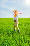 Happy boy playing with toy airplane against blue Royalty Free Stock Photography