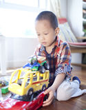 Happy boy playing toy car at home Stock Photo