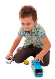 Happy boy playing with toys. Boy playing with toys isolated on white background stock image