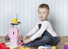 Happy boy playing with toys Royalty Free Stock Photography