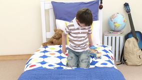 Happy boy playing with a train in his bedroom stock video