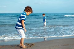 Happy boy plays on beach Stock Photography