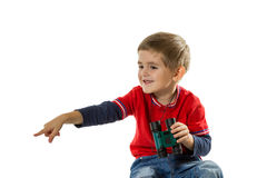 Happy boy pointing with his finger Royalty Free Stock Image