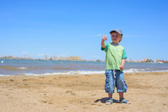 Happy boy pointing with his finger Royalty Free Stock Photography