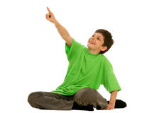 Happy boy pointing out a distant target Stock Photo