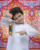 Happy Boy Pointing at Ramadan Lantern Stock Photos