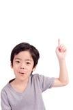 Happy boy pointing up Stock Photos