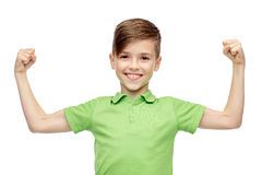 Happy boy in polo t-shirt showing strong fists Stock Photos