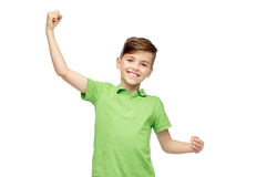 Happy boy in polo t-shirt showing strong fists Royalty Free Stock Photo