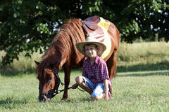 Happy boy with pony horse Royalty Free Stock Photos