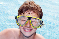 Happy boy in a pool Stock Photography