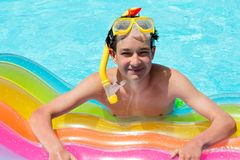 Happy boy in pool Royalty Free Stock Photography