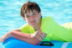 Happy boy in pool Stock Image