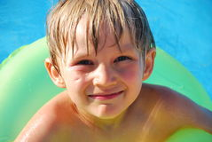 Happy boy in pool Stock Image