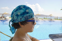 Happy  boy is at the pool Royalty Free Stock Image