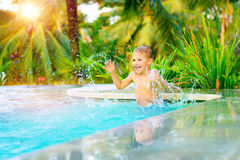 Happy boy in the pool Royalty Free Stock Photo