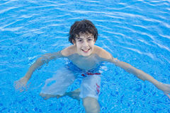Happy boy  in the pool Stock Image