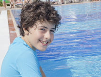 Happy boy at the pool Royalty Free Stock Photo