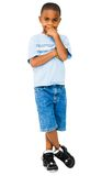 Happy boy posing. With his hand on his chin isolated over white Royalty Free Stock Photo