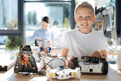 Happy boy posing with his robot models Stock Images