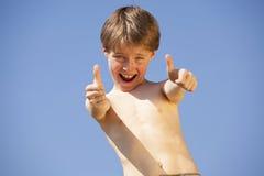 Happy boy posing thumbs up Stock Image