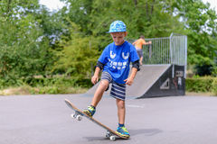 Happy boy practicing balancing on a skateboard Stock Photography