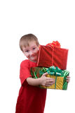 Happy boy with presents Royalty Free Stock Photos