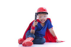 Happy boy pretending to be a superhero with toy gun. On white background Royalty Free Stock Photos