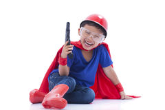 Happy boy pretending to be a superhero with toy gun. On white background Stock Photos