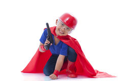 Happy boy pretending to be a superhero with toy gun Royalty Free Stock Photos