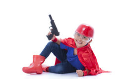 Happy boy pretending to be a superhero with toy gun. On white background Stock Photography