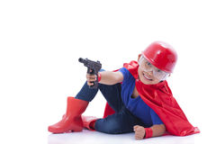 Happy boy pretending to be a superhero with toy gun. On white background Stock Images