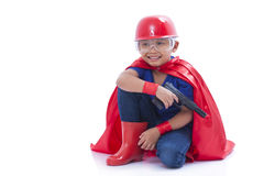 Happy boy pretending to be a superhero with toy gun. On white background Royalty Free Stock Photo