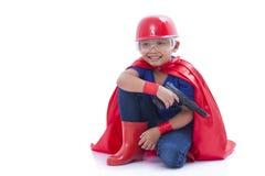 Happy boy pretending to be a superhero with toy gun Royalty Free Stock Photo