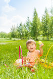 Happy boy with rabbit sitting on green grass Royalty Free Stock Photography