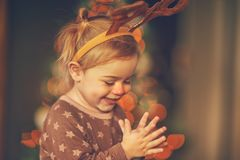 Happy boy in raindeer costume royalty free stock photos