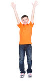 Happy boy with raised hands up. Stock Photo