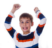 Happy boy raising his hands like a winner Stock Image