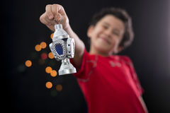 Happy Boy with Ramadan Lantern. On Defocused Night Lights Background Stock Photo