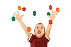 Happy boy reaching for the falling easter eggs Royalty Free Stock Photos