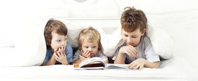 Happy boy read book. Home stock image