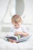 Happy boy read book Royalty Free Stock Photos