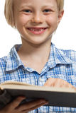 Happy boy reading book Royalty Free Stock Photos