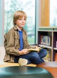 Happy Boy Reading Book In Library Royalty Free Stock Photo