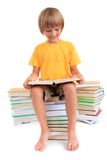 Happy boy reading books Royalty Free Stock Images