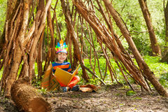 Happy boy reading stories of Red Indians in wigwam Stock Photos