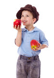Happy boy with red apples Royalty Free Stock Images